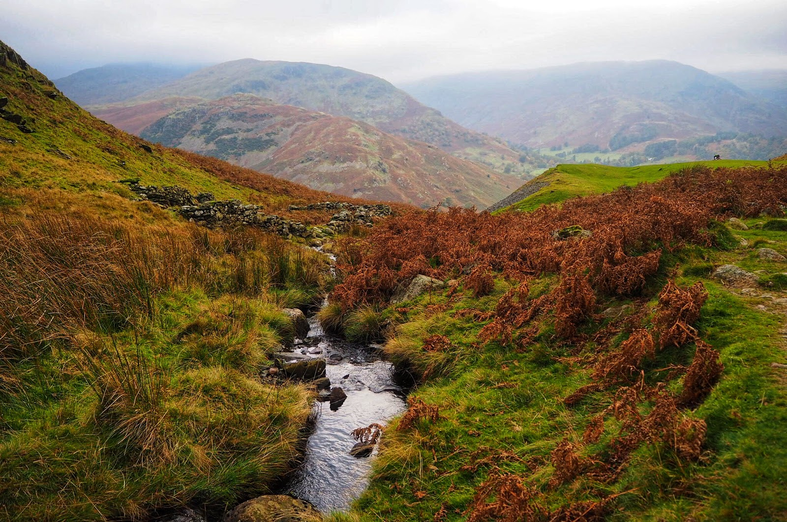Beautiful autumnal colours with mini stream viewed from atop Ullswater Lake District