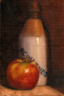 Oil painting of a ginger beer bottle beside a Pink Lady apple.