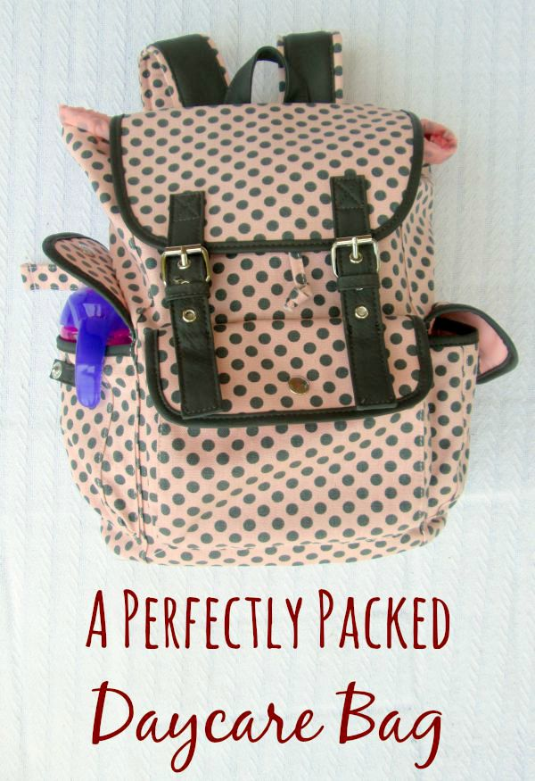 A perfectly packed daycare bag- Everything you need to pack in a bag with your child when they leave for daycare. Includes a printable checklist.