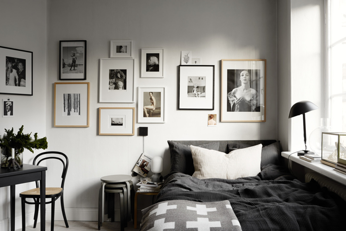 Modern and simple gallery wall in bedroom-photography Kristofer Johnsson