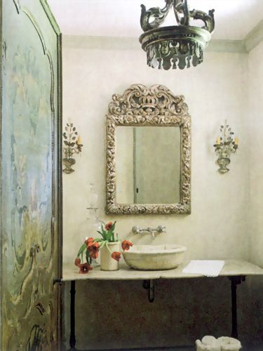 Exquisite old world bathroom design with stone sink by Eleanor Cummings