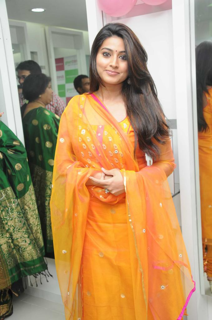 Actress Sneha Long Hair Photos In Orange Dress