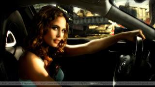 josie maran, model, actress, sitting in the car, holding staring, ready for drive, josie maran moisturizer