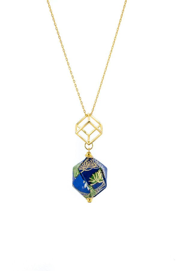 blue patterned paper origami pendant on gold necklace chain
