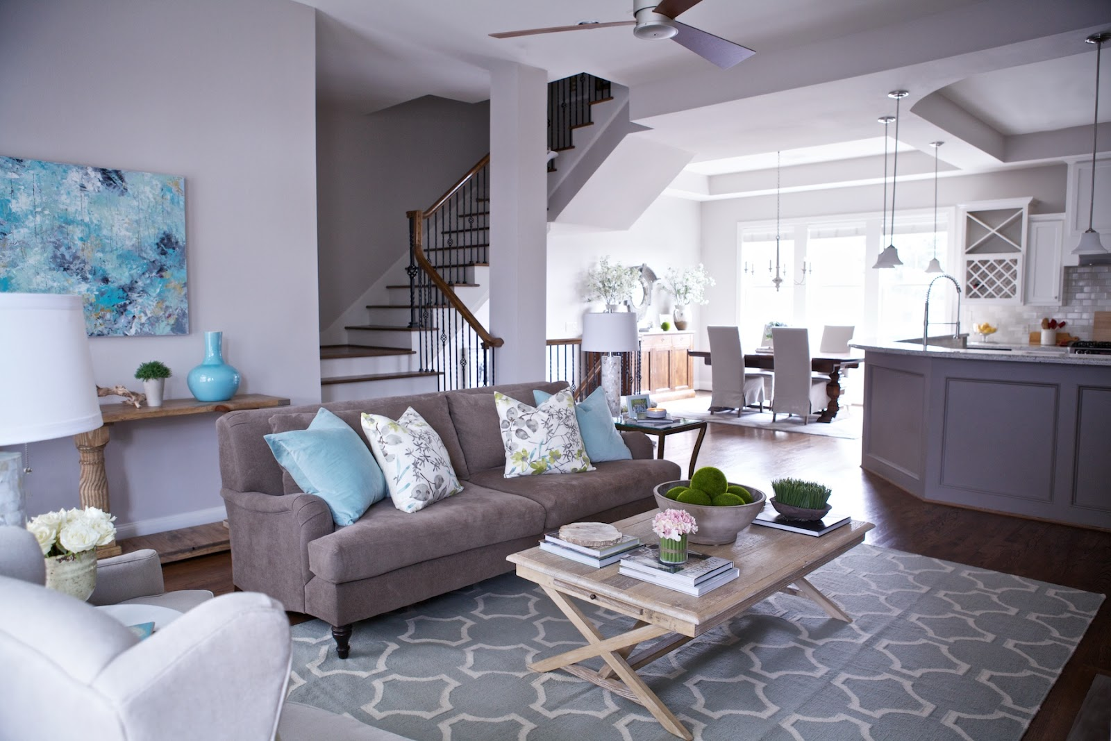 Gray Livingroom And White Kitchen Cabinets