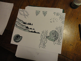 Ammonite, trees and leaf stamps added, with masking fluid