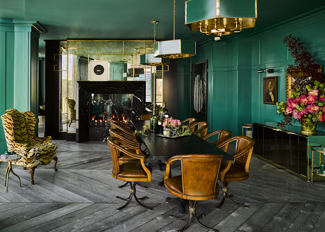 Dramatic teal green painted walls mirrored fireplace dining room Ken Fulk