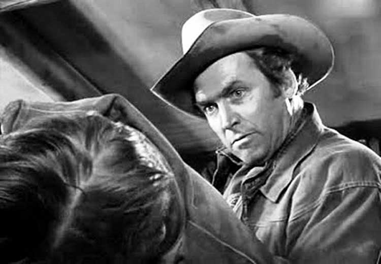 Jimmy Stewart threatens a thug in Winchester '73, directed by Anthony Mann.