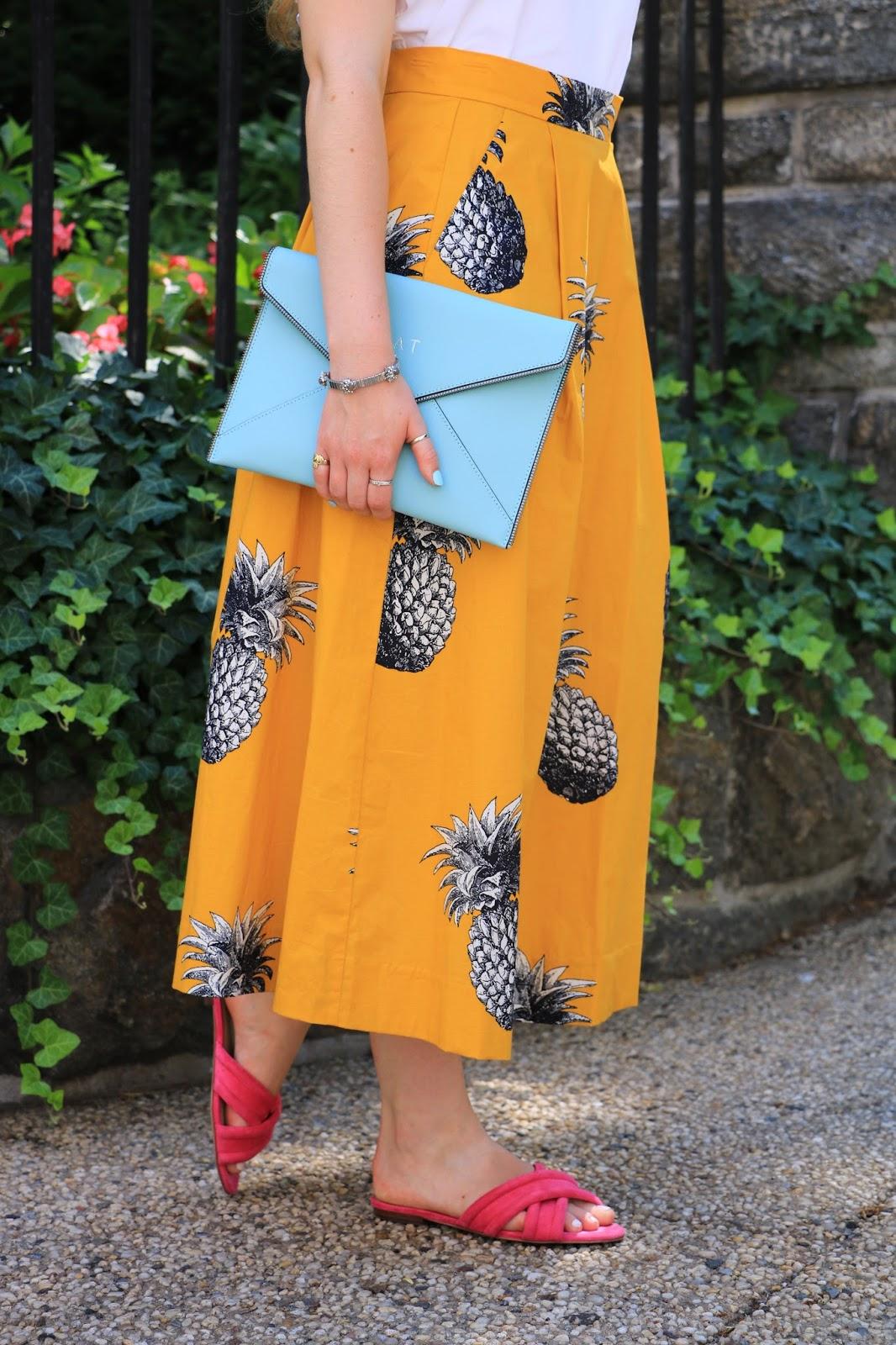 Fashion blogger Kathleen Harper wearing a pineapple skirt with pink slides