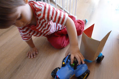 Child playing with ELC tractor toy
