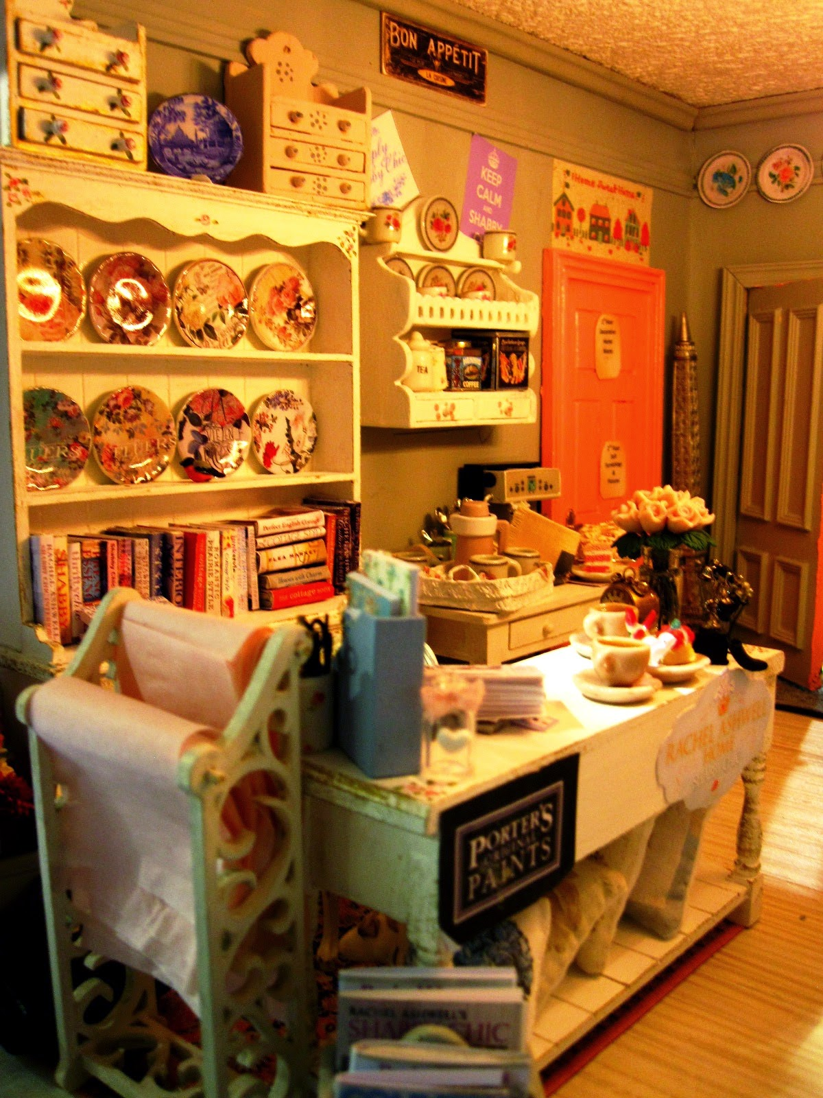 Close up view of a modern shabby chic shop, showing the counter area with plate racks behind it.