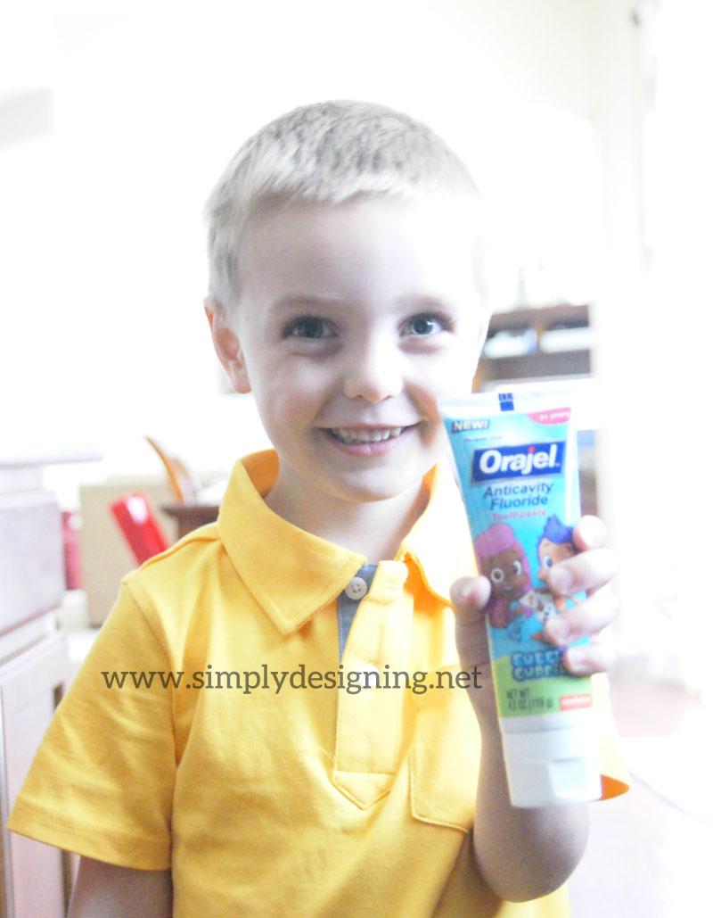 Son+holding+toothpaste 5 Tips to Make the Dentist Easier for Kids #Orajel #Smilestones #ad 8