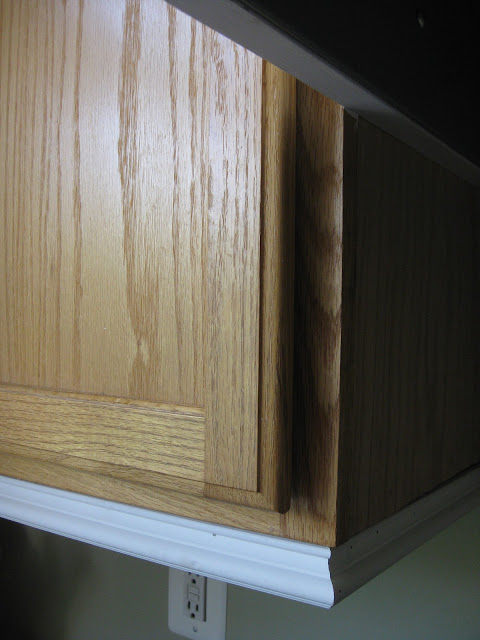 diy - builders grade kitchen cabinets upgraded with moldings