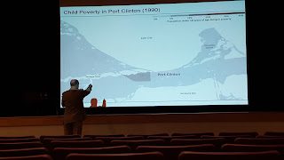 Dr Putnam pointing out details on the map of Port Clinton, OH