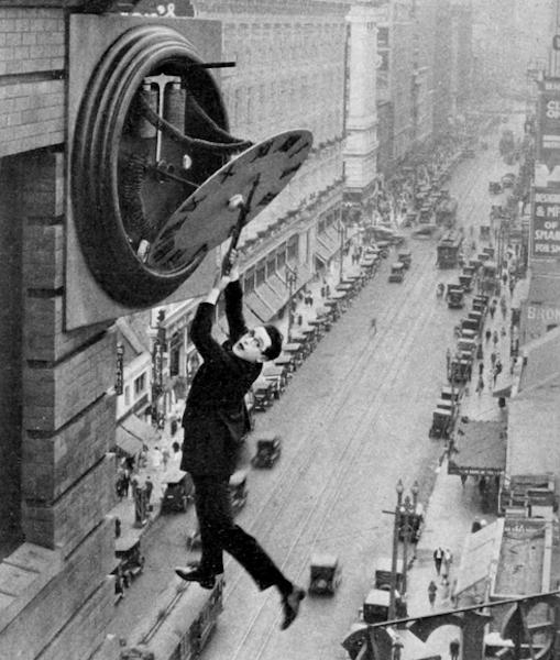 Harold Lloyd hanging from clock
