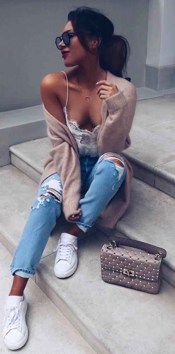 what to wear with a cshmere cardigan : ripped jeans + bag + lacer top + sneakers