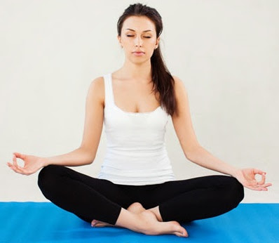 The Sukhasana posture with fingers in Gyana Mudra position