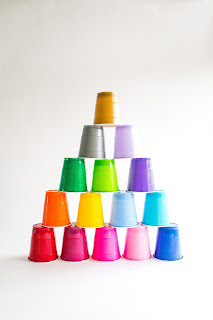 pyramid of multi-colored plastic cups