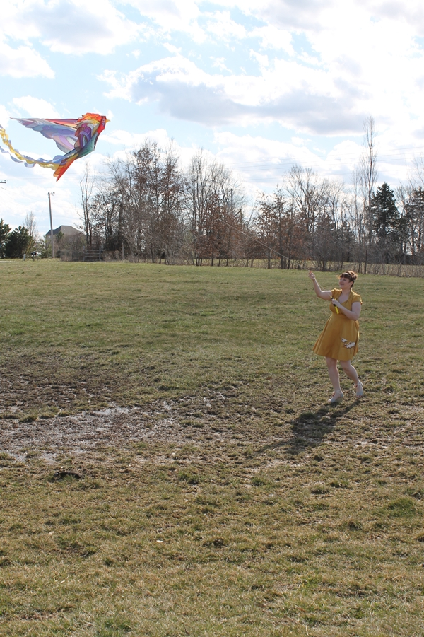 flying a kite in vintage style mustard crane dress from eshakti