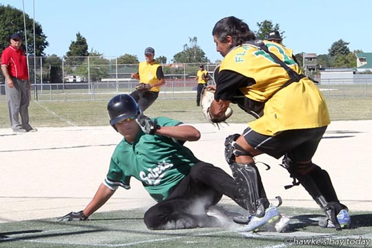 L-R: Tridon McClutchie, Saints, safe home; Darryl Tamati, backstop, Flaxmere - softball at Akina Park, Hastings. photograph