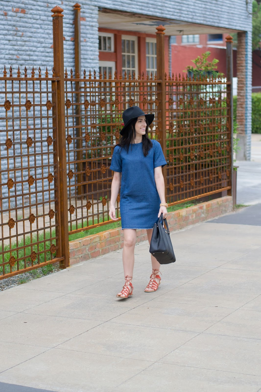 Easy weekend style in denim dress, black wool hat and lace up sandals
