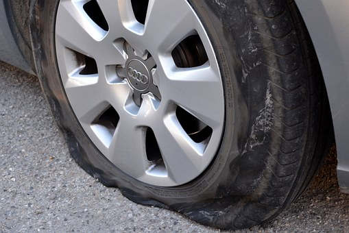 what should i do if my car tyre is flat while driving uber