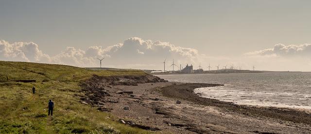 Photo of people walking along the coastal path towards Flimby