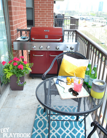Our summer balcony decor is functional and fun. The heavy turquoise placemats won't blow away in the wind, and the citronella candle keeps bugs away and gives off a lovely glow!