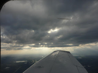 A scary encounter with a real UFO while flying on an airplane.