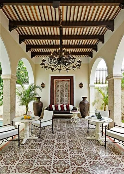 Terracotta Pots Decorative Tile Intricate Ironwork Carved Wood Arched Entry Door All The Characteristics Of Spanish Style Photographed By Laure Joilet