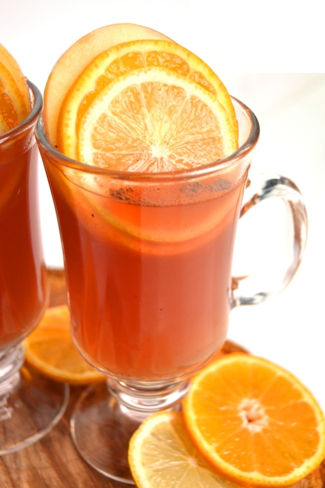 Cranberry, Lemon and Orange Cider is the perfect non-alcoholic beverage for the holidays that is best served hot but is delicious cold as well! A mix of cranberry, lemon and orange juice with cinnamon and fresh fruit. www.nutritionistreviews.com
