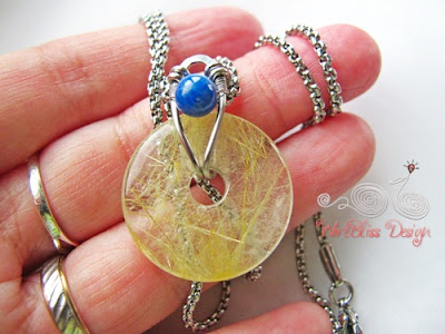 Wire Wrap Rutilated Donut by WireBliss