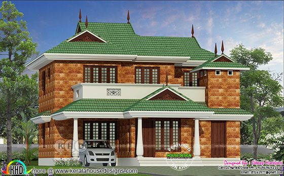 1792 square feet traditional laterite stone Kerala home