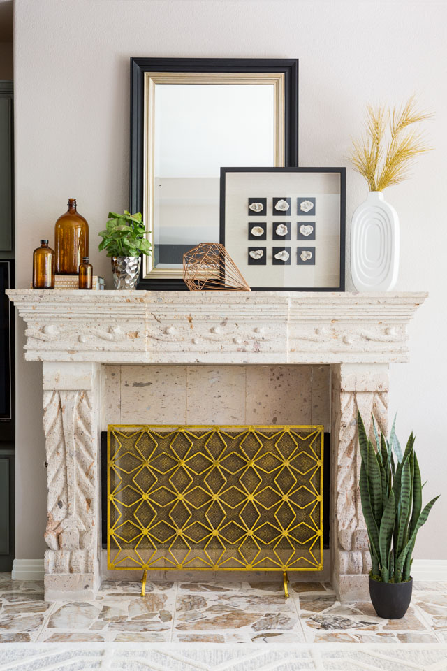 This modern gold screen completely transforms the fireplace!