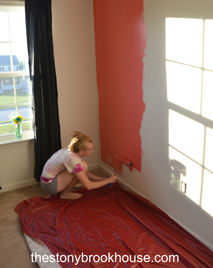 Daughter painting accent wall
