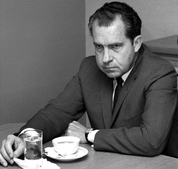 Richard Nixon looking downcast over a cup of coffee. I am not a crook . . . by today's standards. marchmatron.com