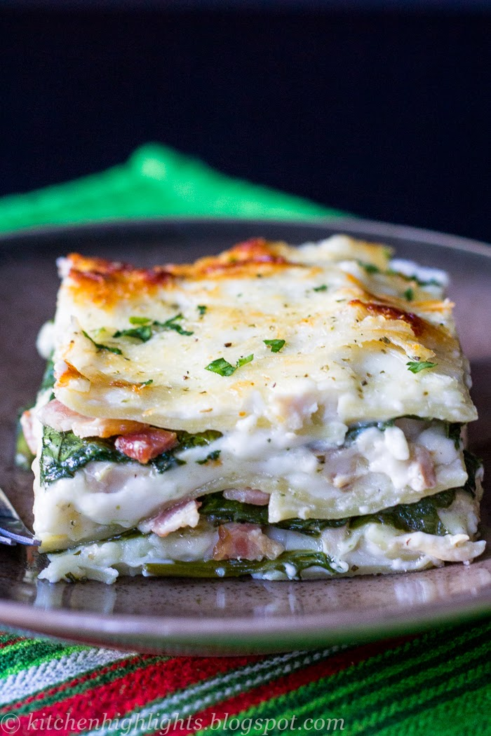 Chicken Florentine lasagna consists of layers of curly noodles separated by a rich béchamel sauce, chicken, fresh spinach and bacon topped with Parmesan and mozzarella cheese