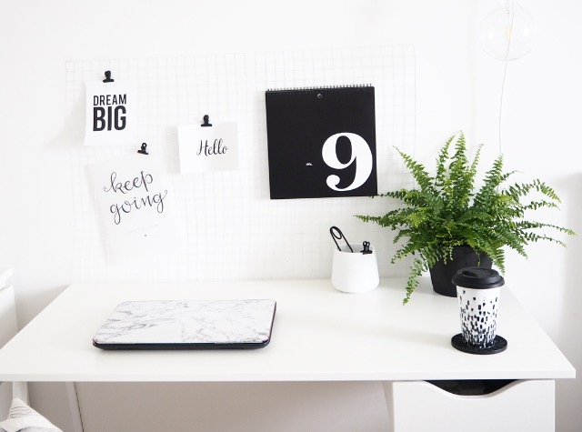 a minimalistic desk with monochrome details