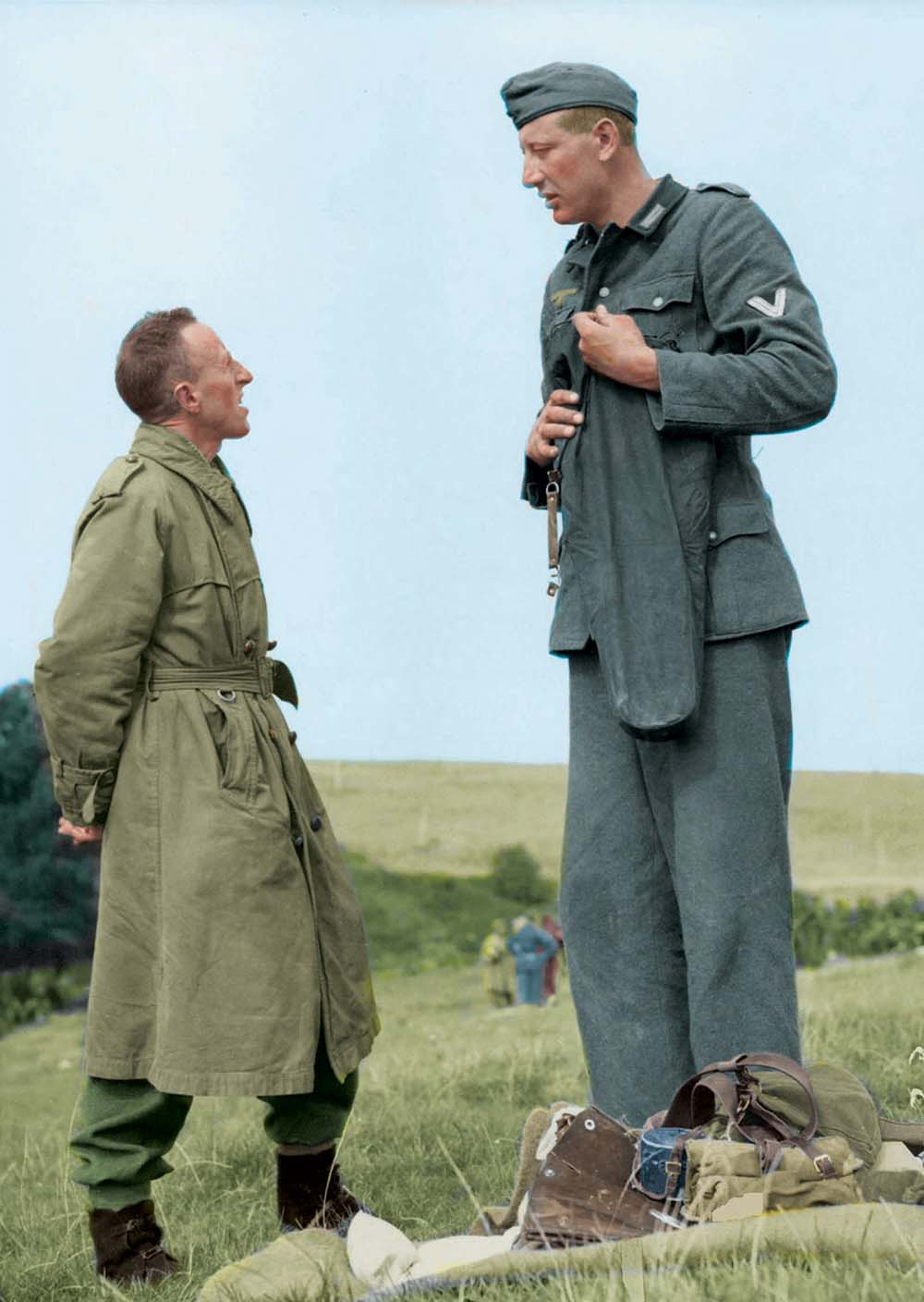 7'3'' Jakob Nacken (221 cm), the tallest German soldier of WW2, chatting with 5'7'' (170 cm) Eddie Worth, AP photographer with the wartime still picture pool, after his surrender.