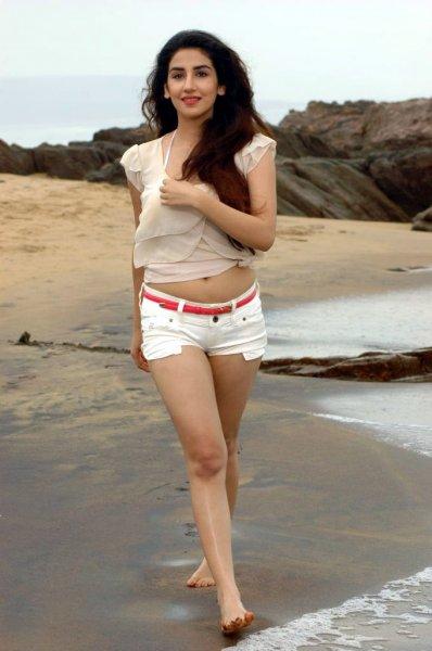 Parul gulati in white dress stills on beach