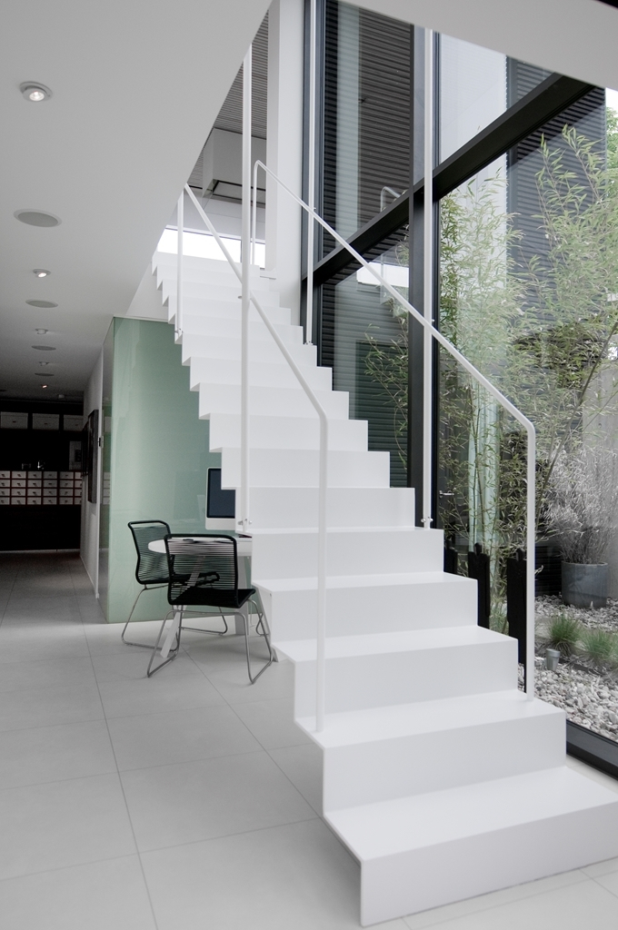 White minimalist stairs in Modern beach house in Sweden