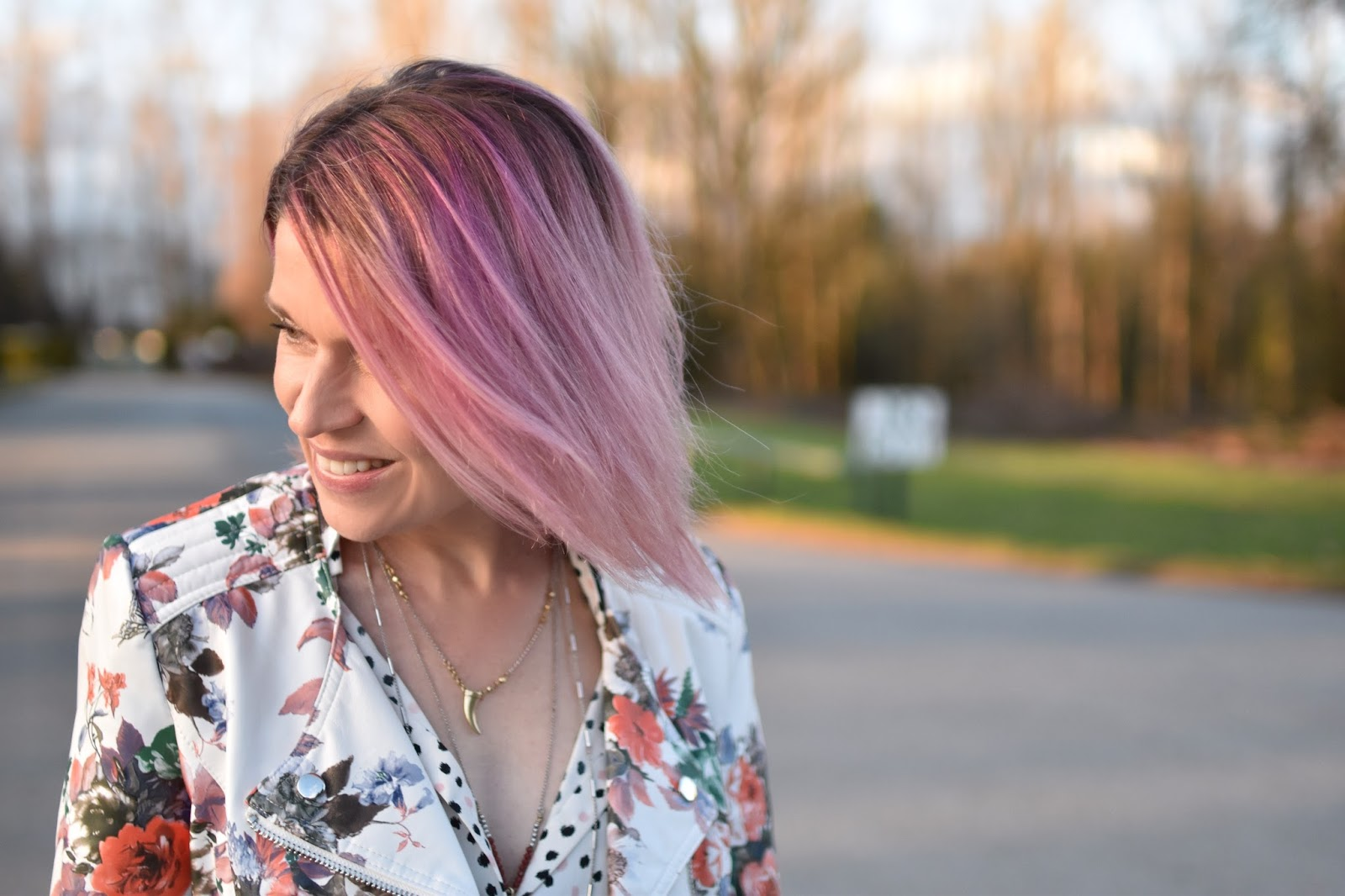 Monika Faulkner outfit inspiration - polka-dotted blouse, floral moto jacket, pink hair