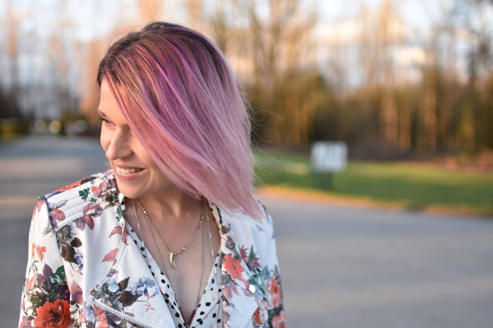 Monika Faulkner outfit inspiration - polka-dotted blouse, floral moto jacket, pink hair