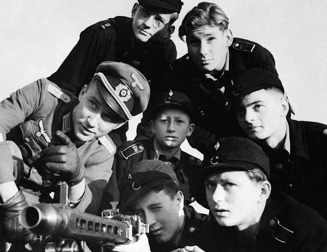 A group of Hitler youth receive instruction in the use of a machine-gun, somewhere in Germany, on December 27, 1944.