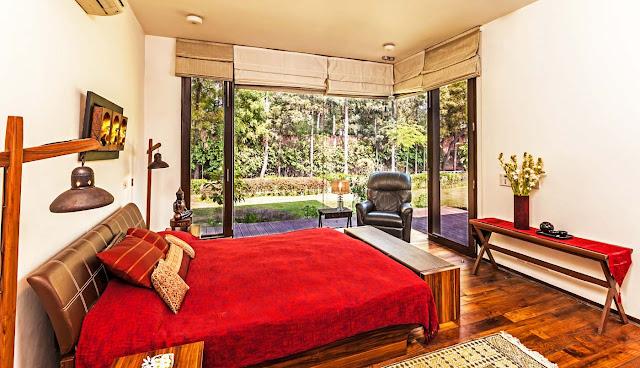 Open Master Bedroom interior design of Farm House by Kumar Moorthy & Associates