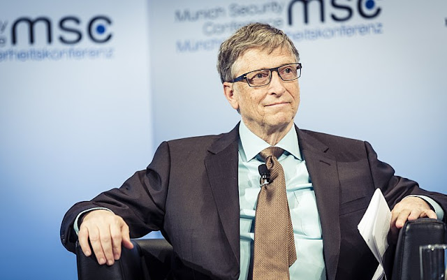 bill gates sitting on a chair