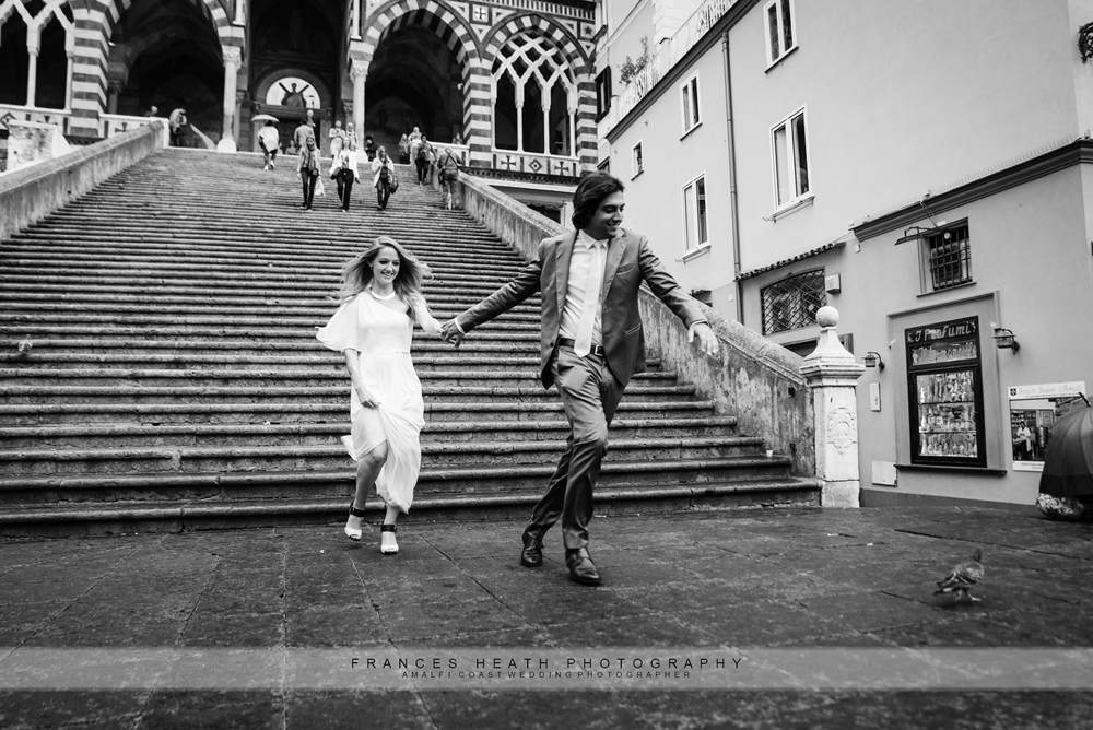 Bride and groom running in Amalfi