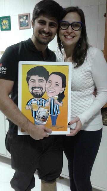O casal e suas caricaturas M2LOPES