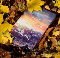 book The Rent Collector in a pile of leaves
