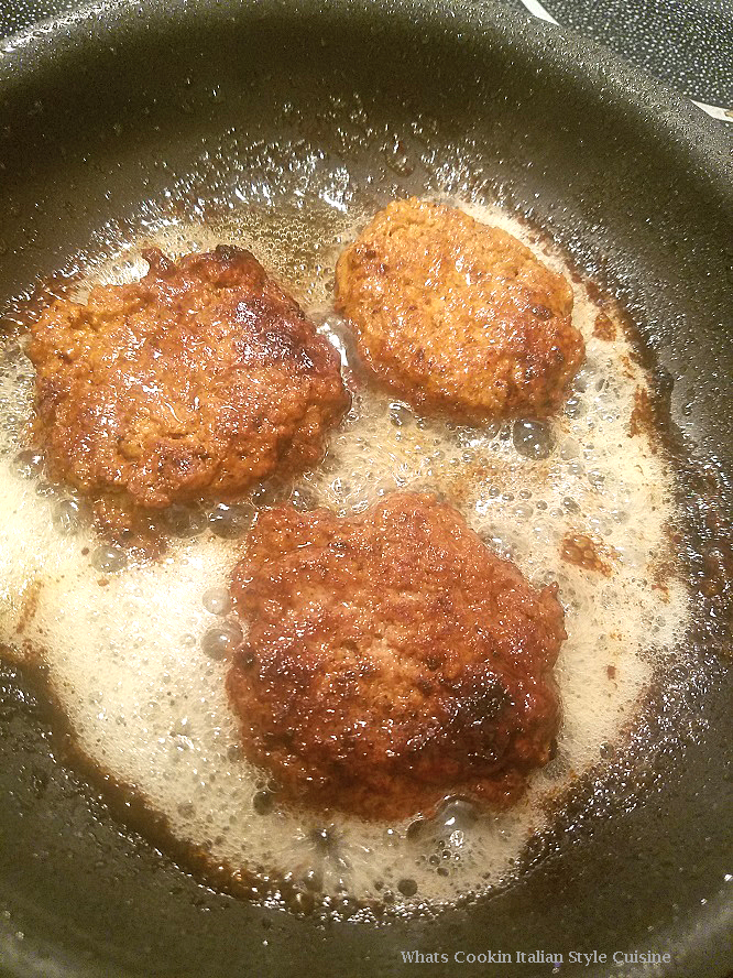 these are breakfast sausages frying in a fry pan